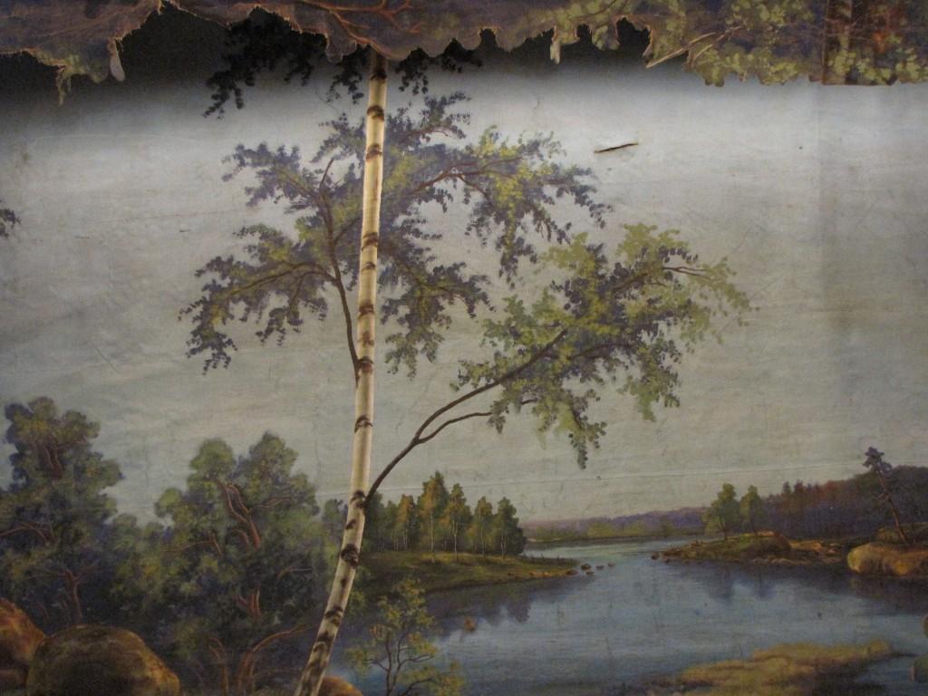 Yksityiskohta Pessalan maalaamasta Maakansan  seuratalon taustakankaasta